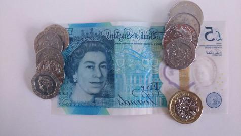 7poundsymedio salario mínimo en Reino Unido 2018